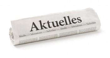 Zeitungsrolle mit der Überschrift Aktuelles